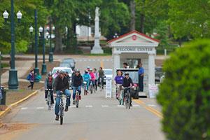 UM Students bicycling on university avenue